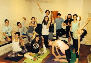 Group of yogis posing post fundraising class